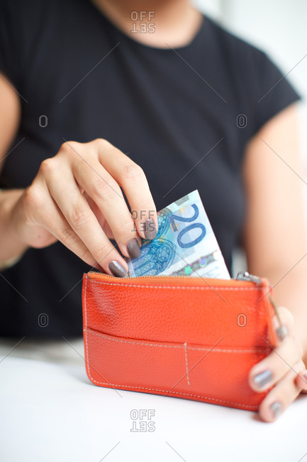 Woman taking out money from purse