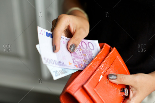 Woman taking out euros from purse