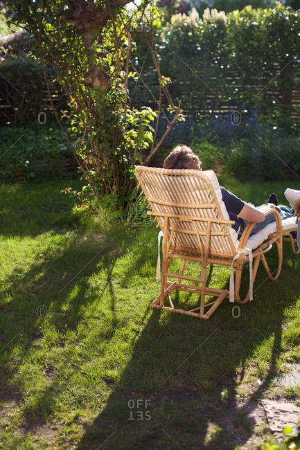 Man relaxing on deckchair