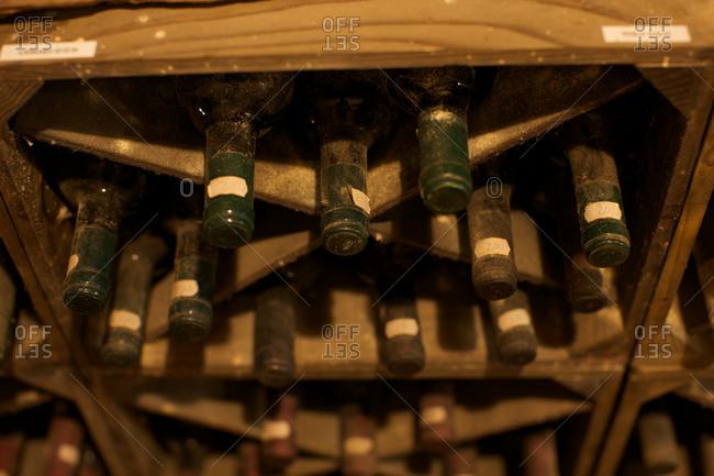 Wine bottles on wooden shelf