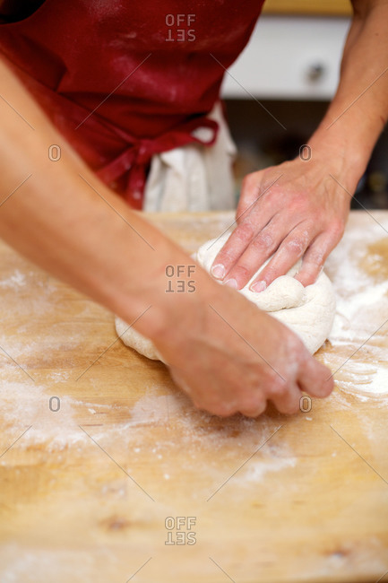 Person forming raw bread dough