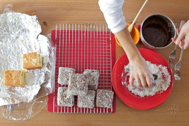 Preparing sponge cake with chocolate and coconut