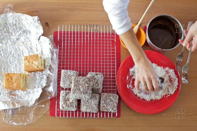 Preparing sponge cake with chocolate and coconut