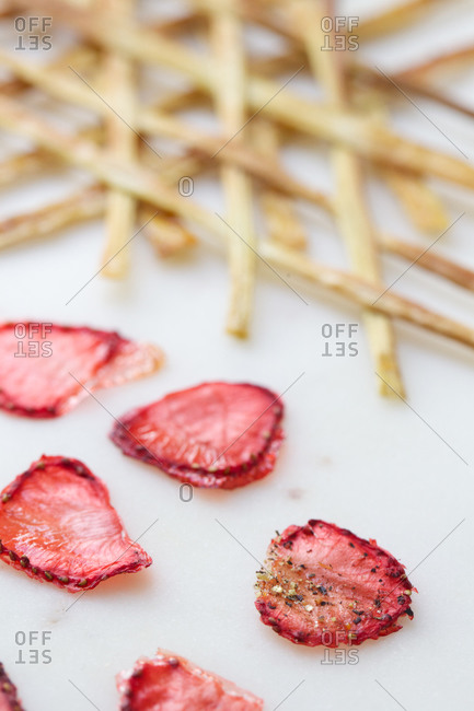 Strawberry and rhubarb chips on white background