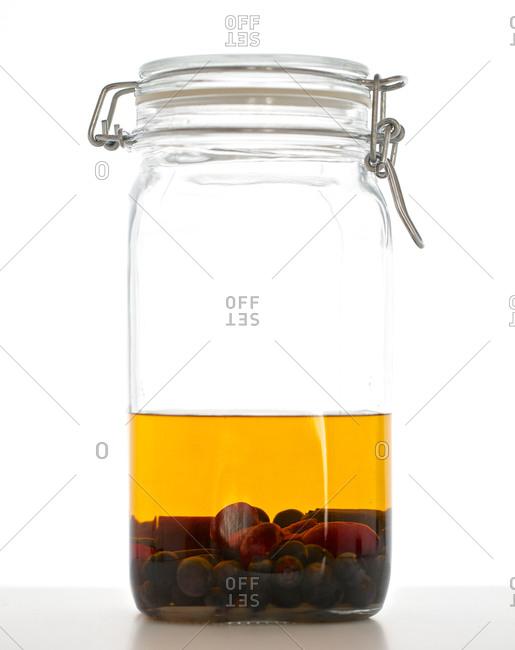 Fruit soaking in jar of rum