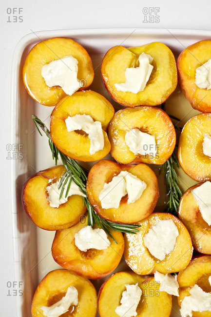 Roasted peaches topped with butter