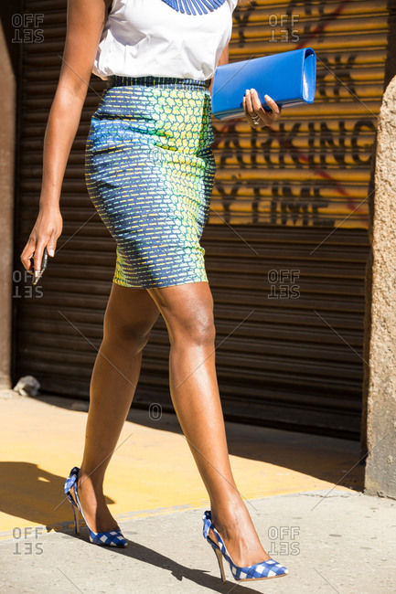 Woman in an iridescent pencil skirt and heels