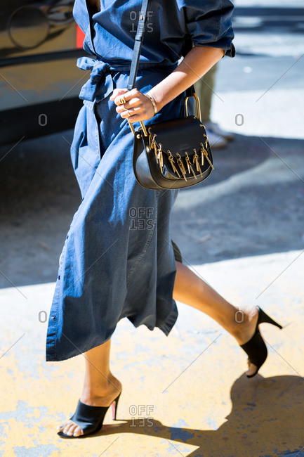 Woman in a long chambray dress and heels