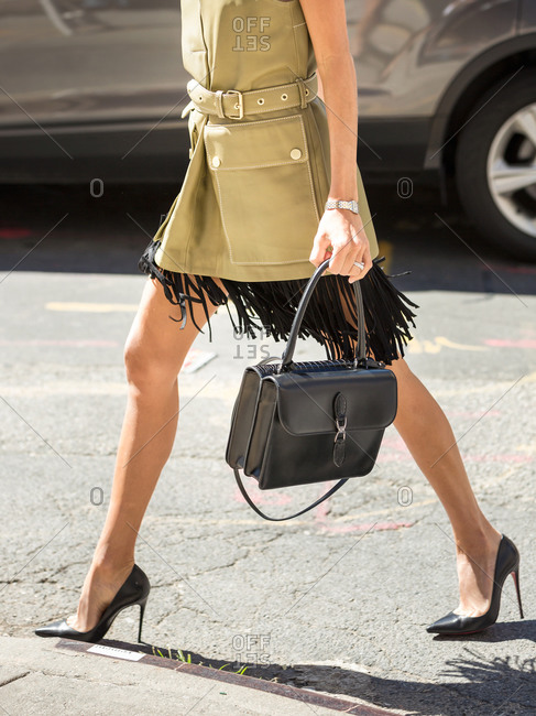 Woman in a fringe skirt and belted vest