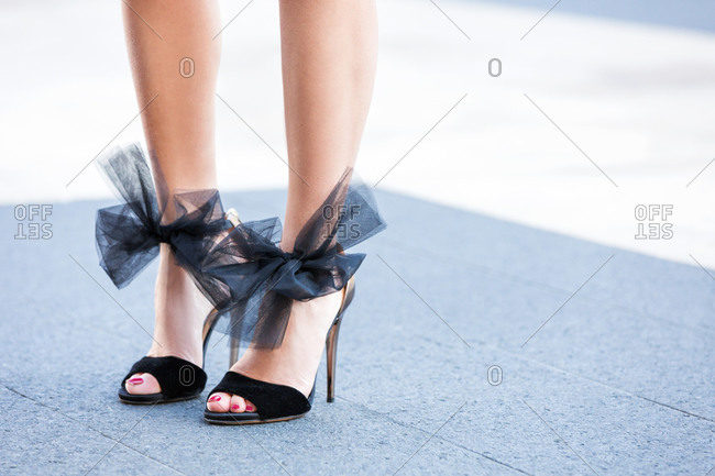 Woman in high heels with tulle bows