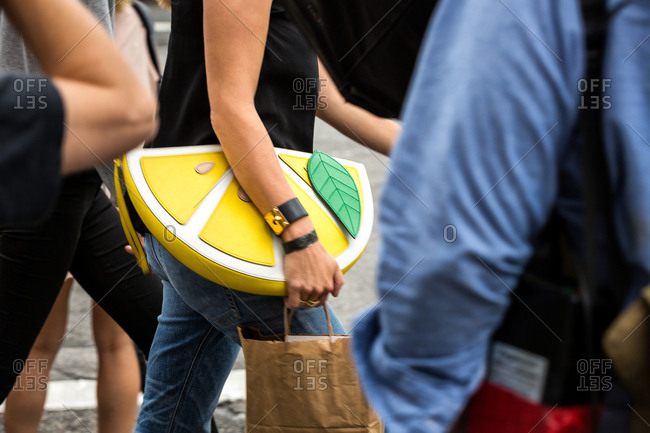 Woman carrying a lemon slice purse