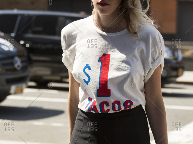 Woman in a taco t-shirt and tight skirt