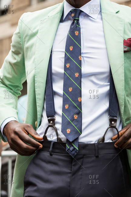 Man in a mint green blazer and suspenders
