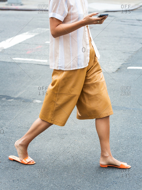 Woman in high-wasted baggy shorts and sandals