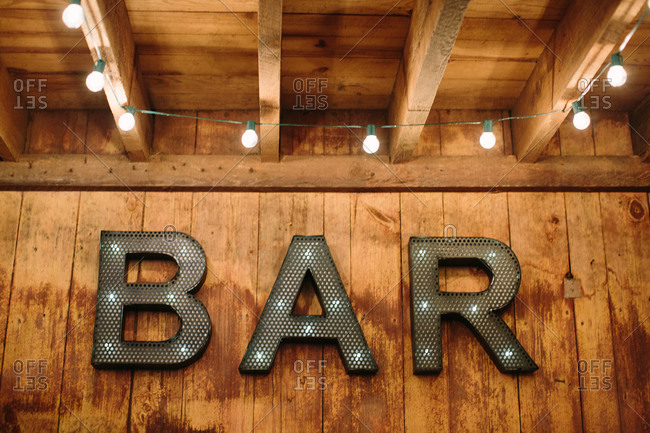 Sign for the bar at a barn wedding