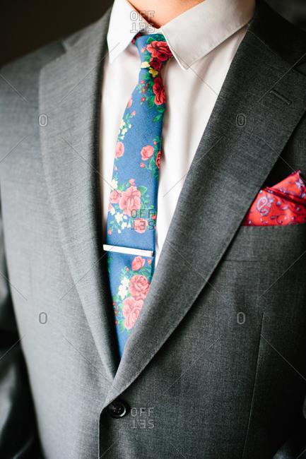 Groom's floral tie and tie clip