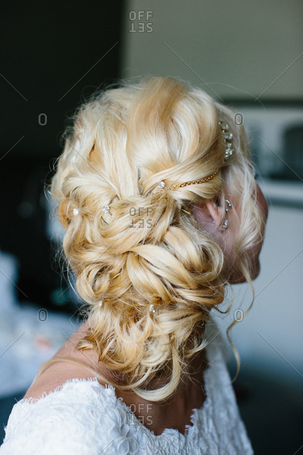 Detail of bride's hairstyle decorated with jewels