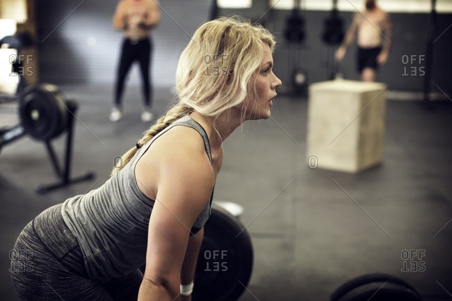 Woman does powerlifting in a gym