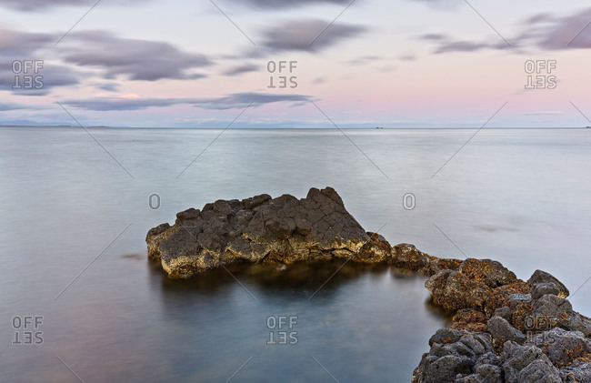 Small outcropping of rocks in sea in Iceland
