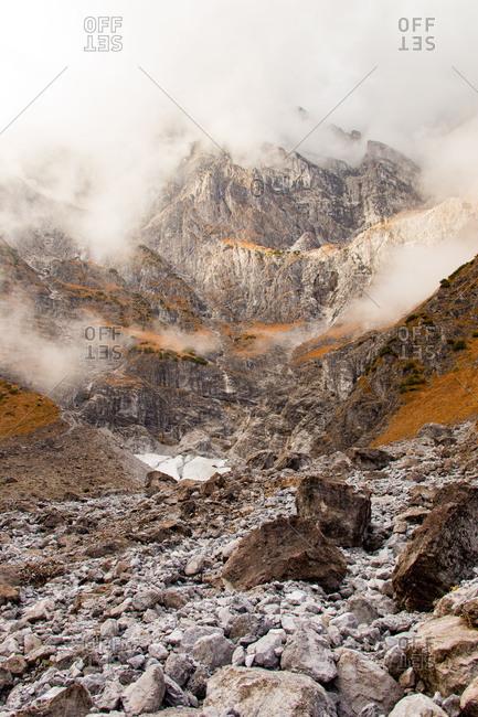 Rocky ravine in the mist in the Bavarian Alps