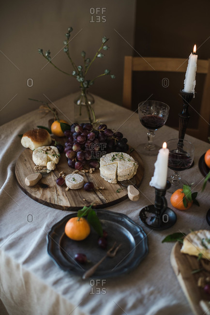 Cheese board with grapes and citrus
