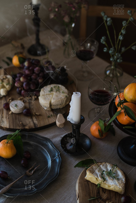 Rustic cheese board with fruit and red wine