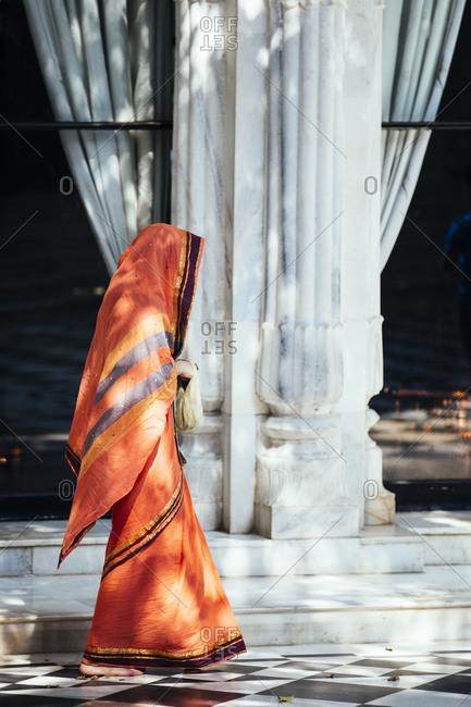 Woman in sari in Hindu temple