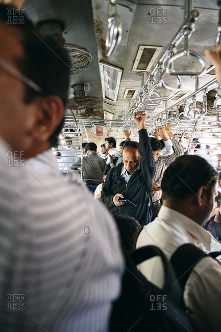 Mumbai, India - January 21, 2015: Passengers on public train in Mumbai