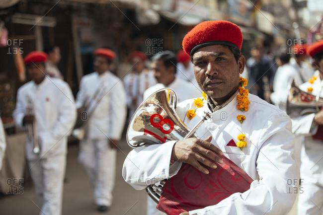 Pushkar, India - February 1, 2015: Man with tuba in parade in India