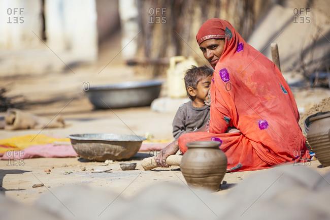 Pushkar, India - February 2, 2015: Woman in sari sitting with son