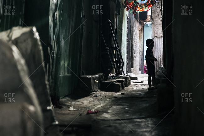 Silhouetted boy in Mumbai slum