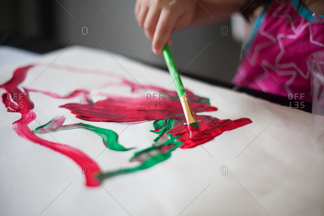 Girl painting with Christmas colors