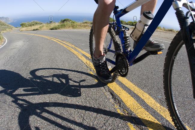 Young man biking Highway 1 near the California Coastal Trail
