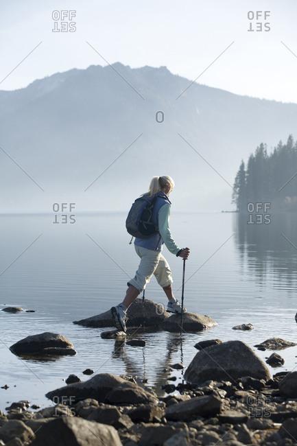 Woman hiking by Fallen Leaf Lake, Lake Tahoe, CA