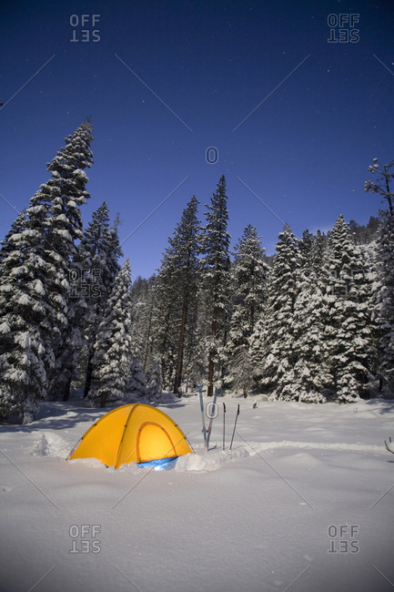 A snow camping tent among trees in South Lake Tahoe, California