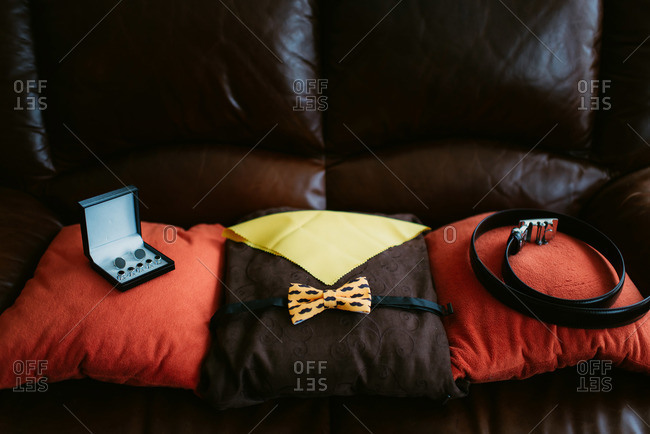 Groom accessories arranged on pillows