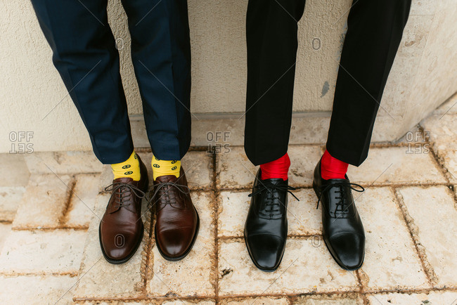 Two men in dress shoes and bright colored socks