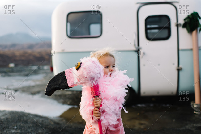 Girl with a homemade pink flamingo toy
