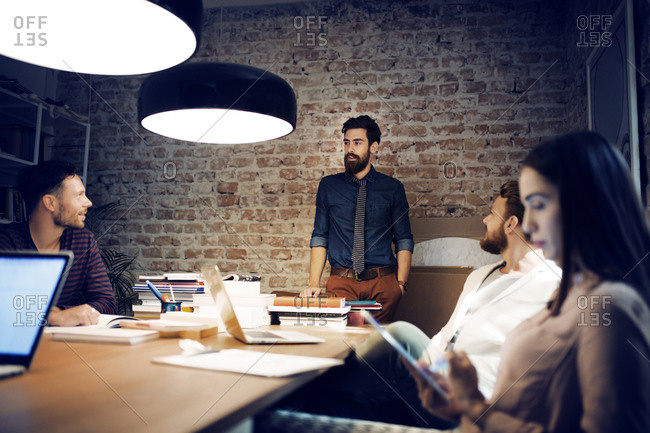 Young professionals collaborate in an office meeting