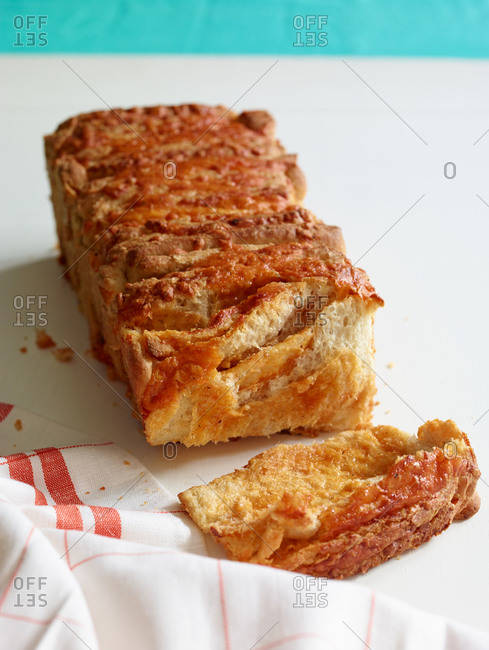 Flaky sweet loaf of bread and slice