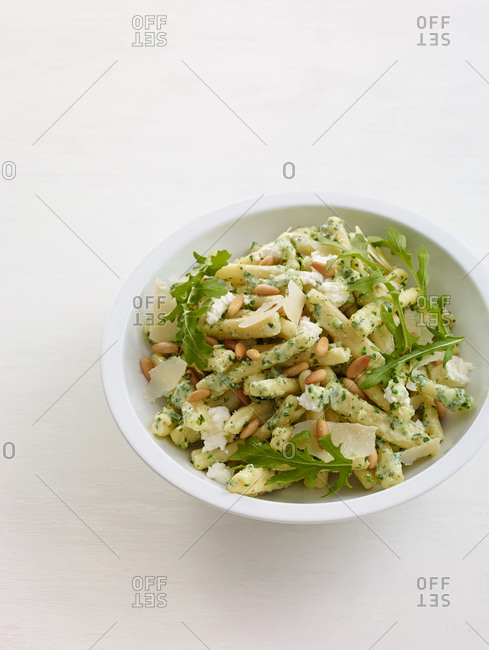 Casarecce noodles with pesto, lettuce, sunflower seeds and cheese