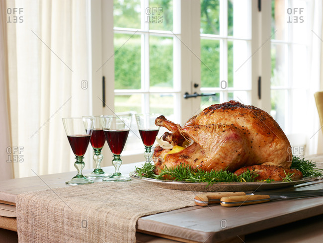 Whole roasted turkey and four glasses of red wine