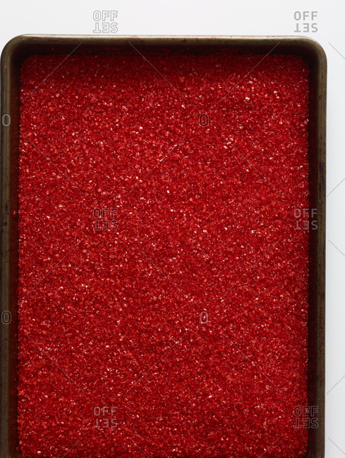 Baking pan filled with red glitter sprinkles