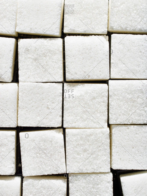 Close up of white sugar cubes