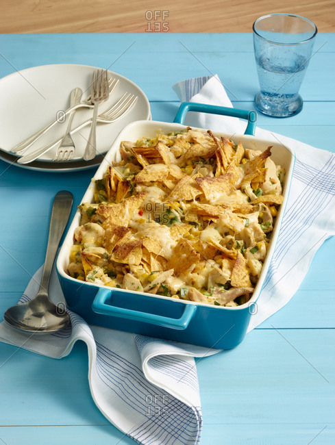 Chicken tortilla pie in a blue casserole dish