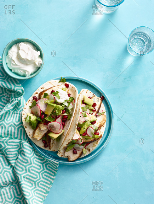 Spiced chicken tacos with avocado and pomegranate salsa