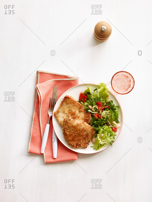 Fried pork chops and a side salad