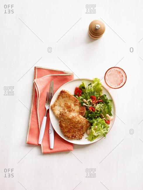 Fried pork chops and a side salad