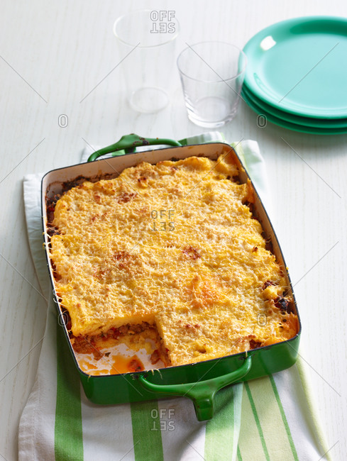 Sausage and pepper polenta lasagna missing a slice