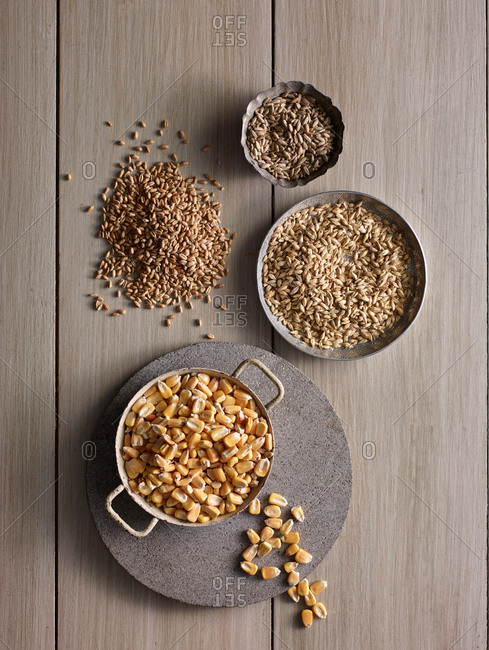 Corn kernels and seeds in metal bowls